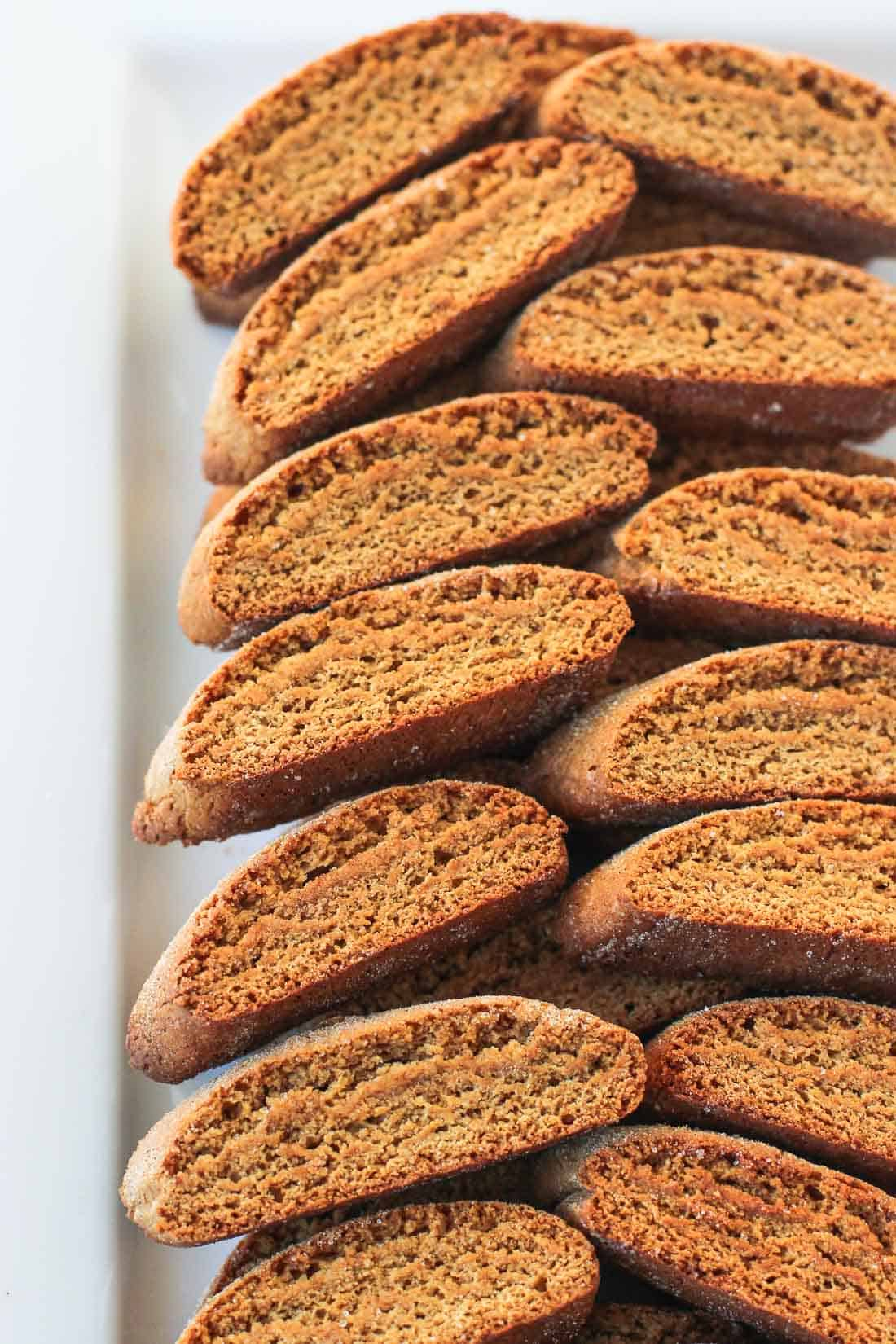 A tray of stacked gingerbread biscotti.