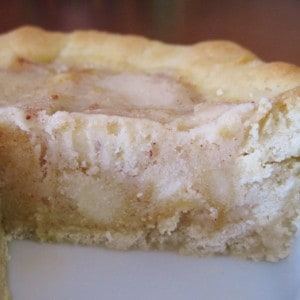 A profile view of gelato pie with a wedge taken out.