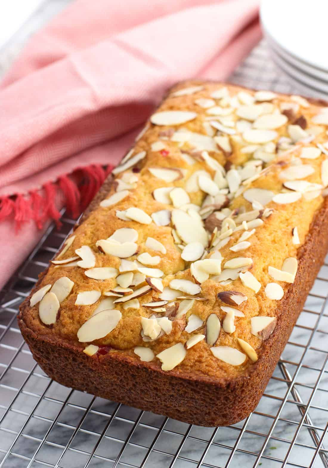 This cherry almond loaf cake is made with dry pudding mix for an ultra moist, vanilla and almond flavored loaf cake. Sliced maraschino cherries and slivered almonds round out this crowd-pleasing dessert.