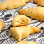 A crescent roll cut in half showing a swirled filling
