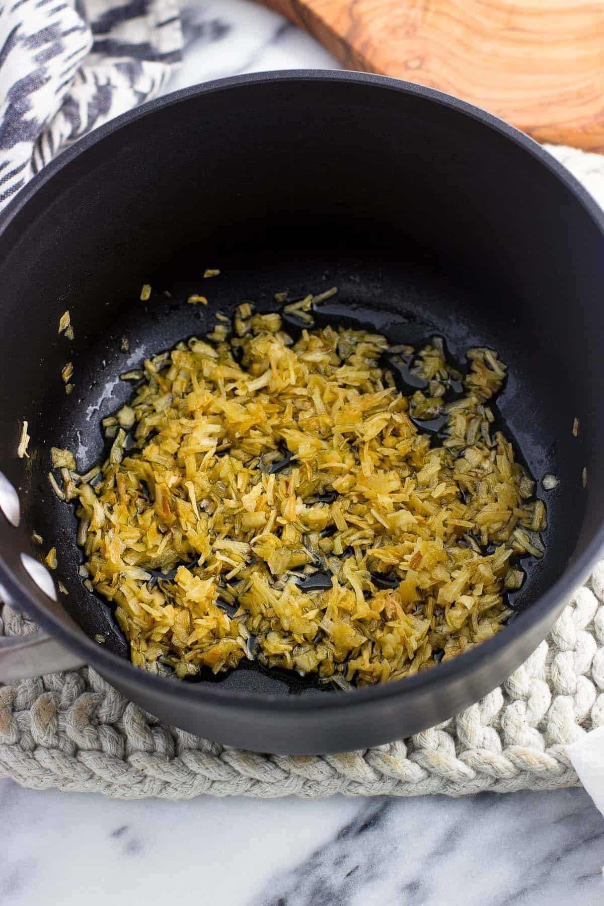 Dried minced onion in a small saucepan with oil