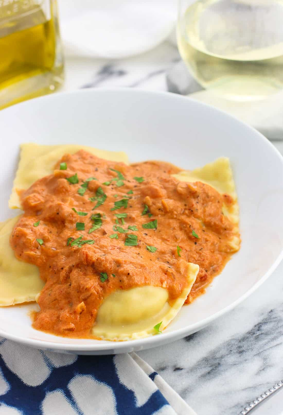This recipe for lightened up vodka sauce is a healthier way to enjoy Italian comfort food. This easy homemade vodka sauce substitutes in fat-free half-and-half for a lower fat but creamy sauce without any worries of it separating.