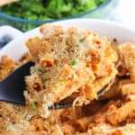 This vodka sauce pasta bake is the ultimate in comfort food. Easy homemade vodka sauce is mixed with ziti, bacon, and cheese and topped with a crispy panko topping in this crowd-favorite main dish