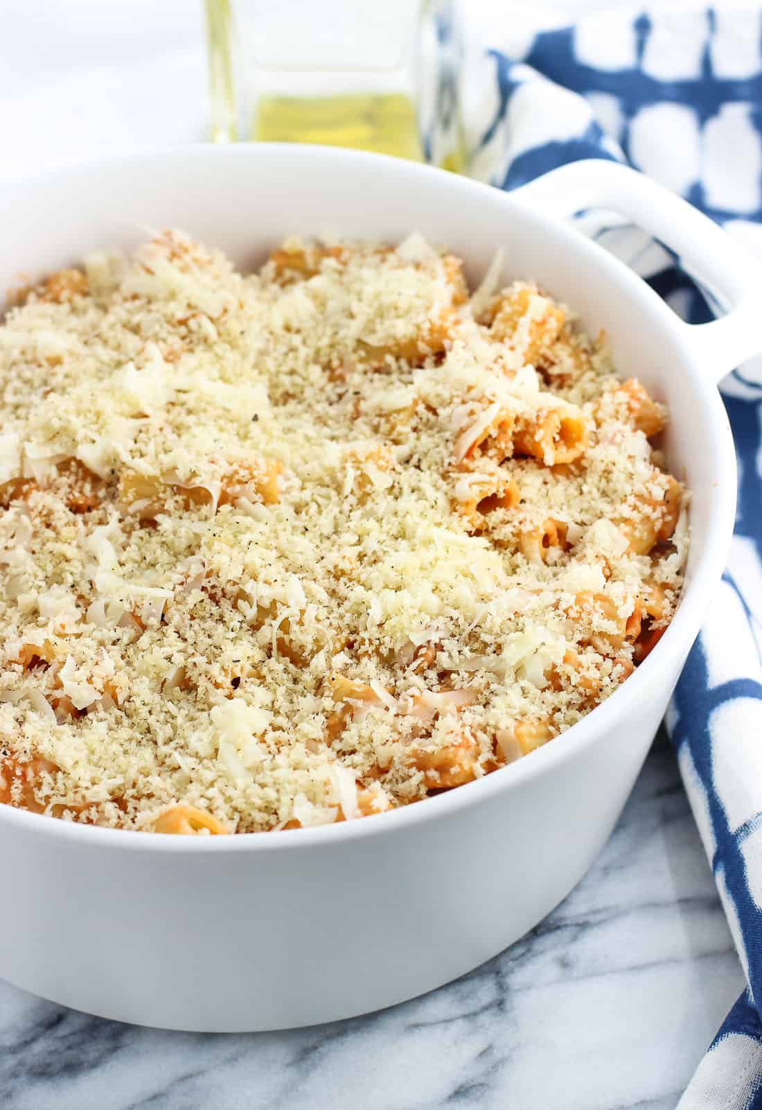This vodka sauce pasta bake is the ultimate in comfort food. Easy homemade vodka sauce is mixed with ziti, bacon, and cheese and topped with a crispy panko topping in this crowd-favorite main dish.