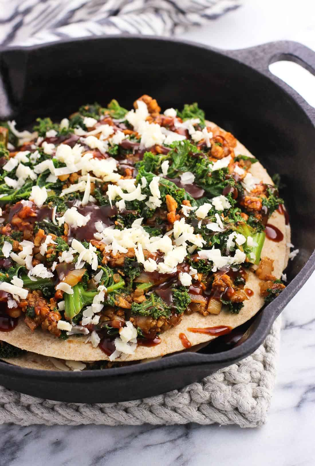 BBQ Tempeh Kale Tortilla Pie is a hearty and delicious vegetarian meal made all in one skillet! This quick recipe makes a great weeknight dinner. It's perfect for Meatless Monday - or any day.