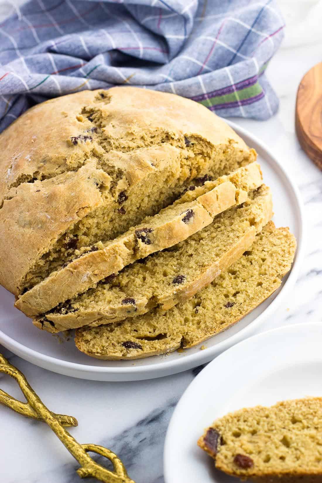 A loaf of maple Irish soda bread halfway sliced