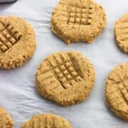 Peanut butter cookies on a sheet of parchment paper.