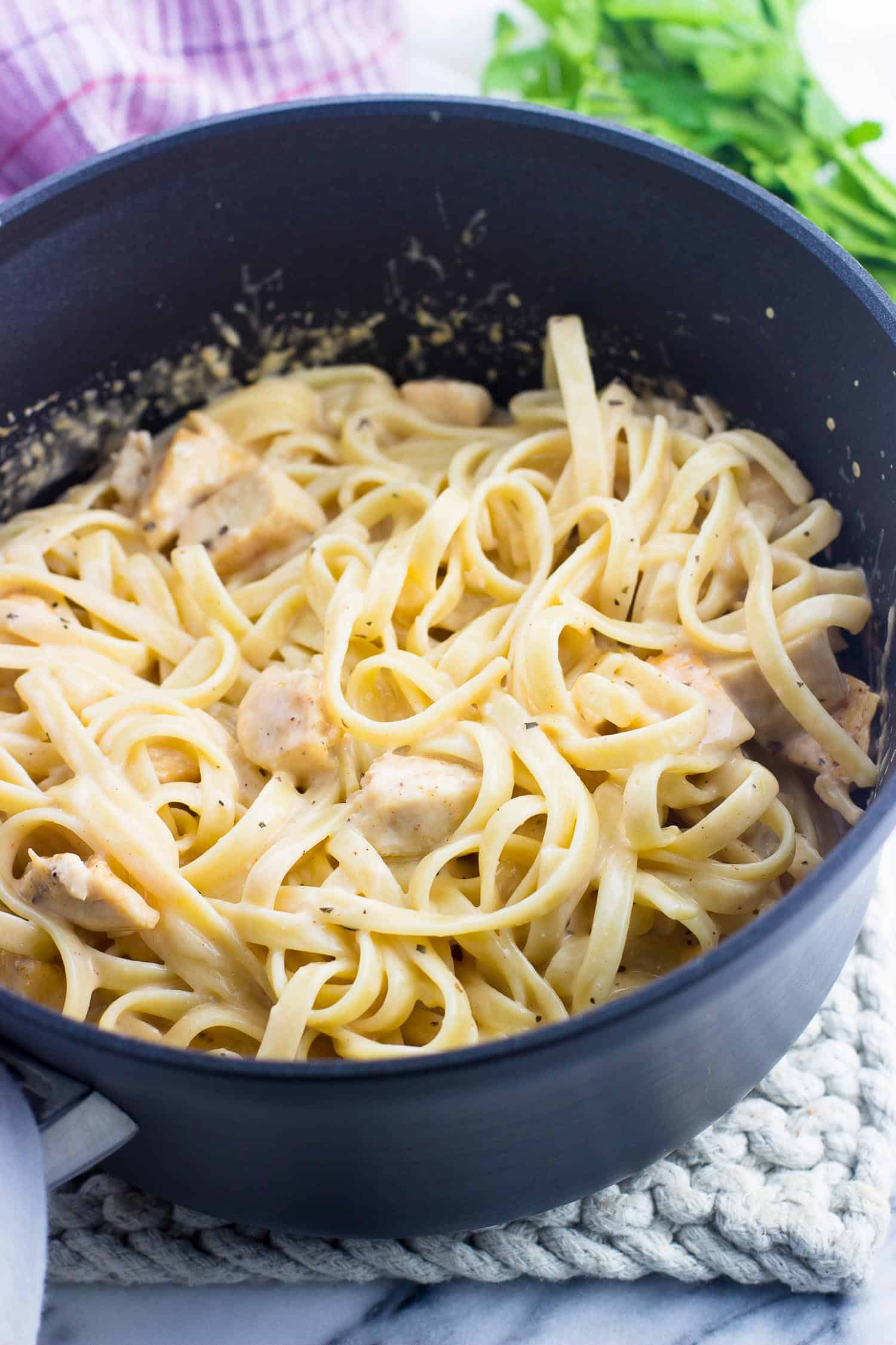Lightened up buffalo chicken alfredo pasta in a saucepan