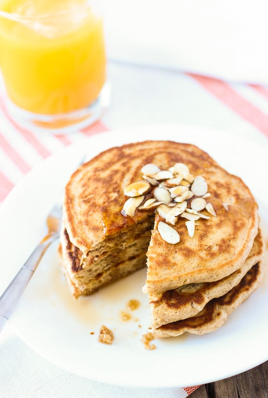 These honey almond crunch pancakes are tall, fluffy, and a whole wheat blend. Full of almond pieces for crunch and flax for a sneaky, nutritious add in!