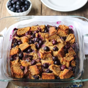 The blueberry french toast bake in a square glass baking dish.