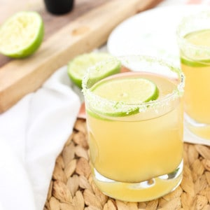 A beergarita in a rocks glass with a lime round and a lime and salt rim