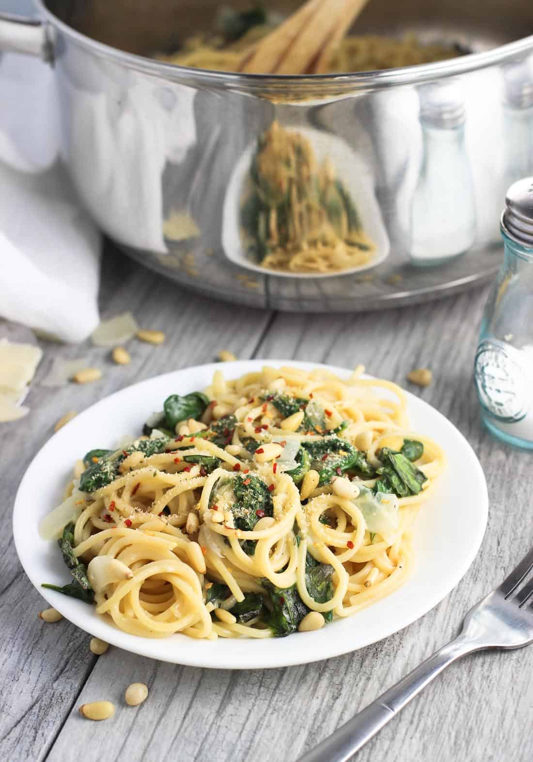 This lemon spinach one-pot pasta recipe is dairy-free and ultra creamy! There's no draining required, and it takes just 30 minutes from start to finish! A great weeknight dinner recipe.