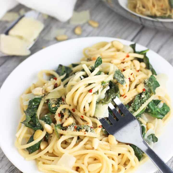 This lemon spinach pasta recipe is dairy-free and ultra creamy! It's made in only one pot so there's no draining required, and it takes just 30 minutes from start to finish! A great weeknight dinner recipe.