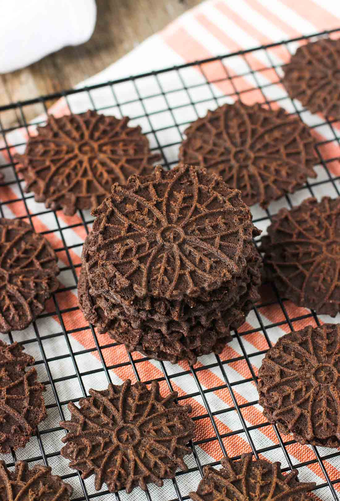 Dark Chocolate Pizzelle - rich and crispy pizzelle cookies that are simple to make! mysequinedlife.com