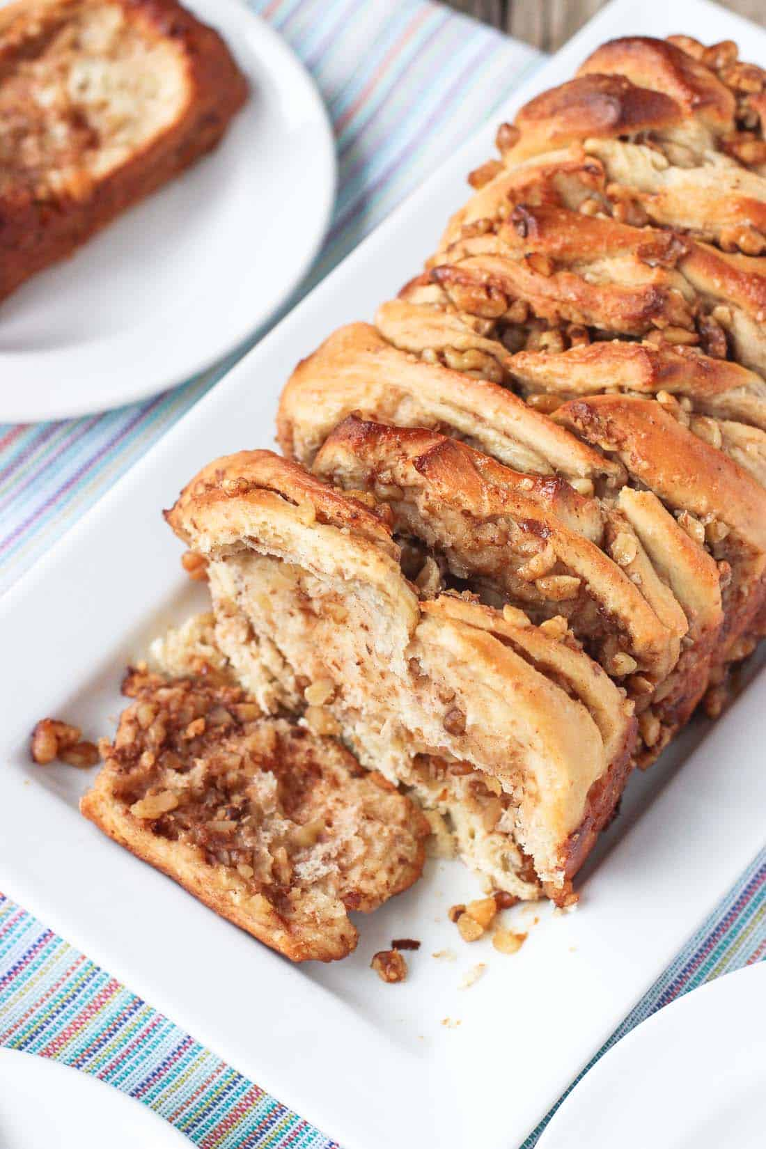 This Maple Walnut Pull-Apart Bread is the perfect bread for brunch (or anytime)! Maple syrup and toasted walnut pieces are bursting throughout this bread with a touch of cinnamon. Plus it's dairy-free!