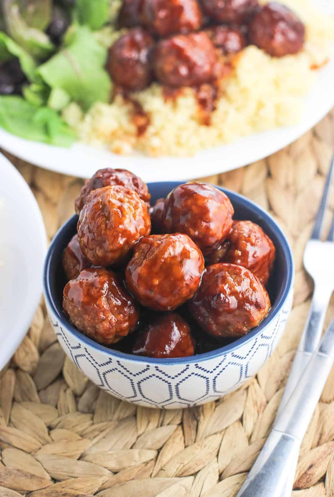 Sweet and Spicy Slow Cooker Meatballs are an easy appetizer or main dish made from pantry and fridge staples. Simple and quick prep!