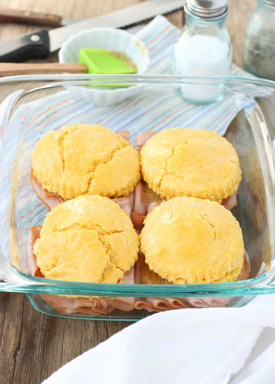 Cornmeal is added to a fluffy biscuit recipe and topped with applewood smoked ham and creamy mustard sauce. These cornmeal biscuit ham sandwiches with honey mustard sauce make a delicious breakfast, brunch, or anytime meal!
