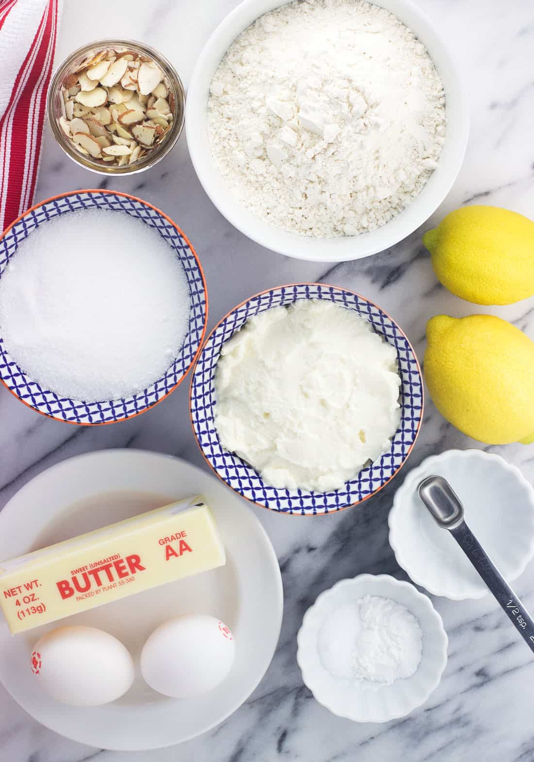 An overhead shot of the lemon ricotta muffin ingredients in separate bowls