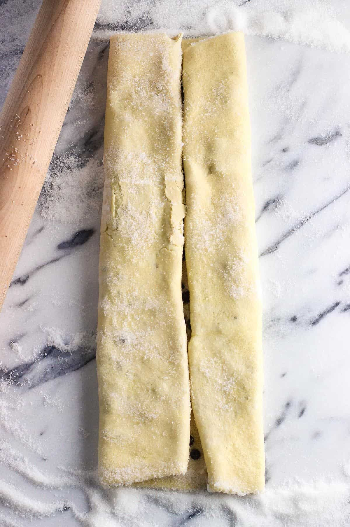 A sheet of puff pastry rolled from both sides to meet in the middle