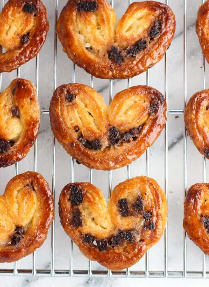 An overhead shot of chocolate chip palmiers on a wire rack