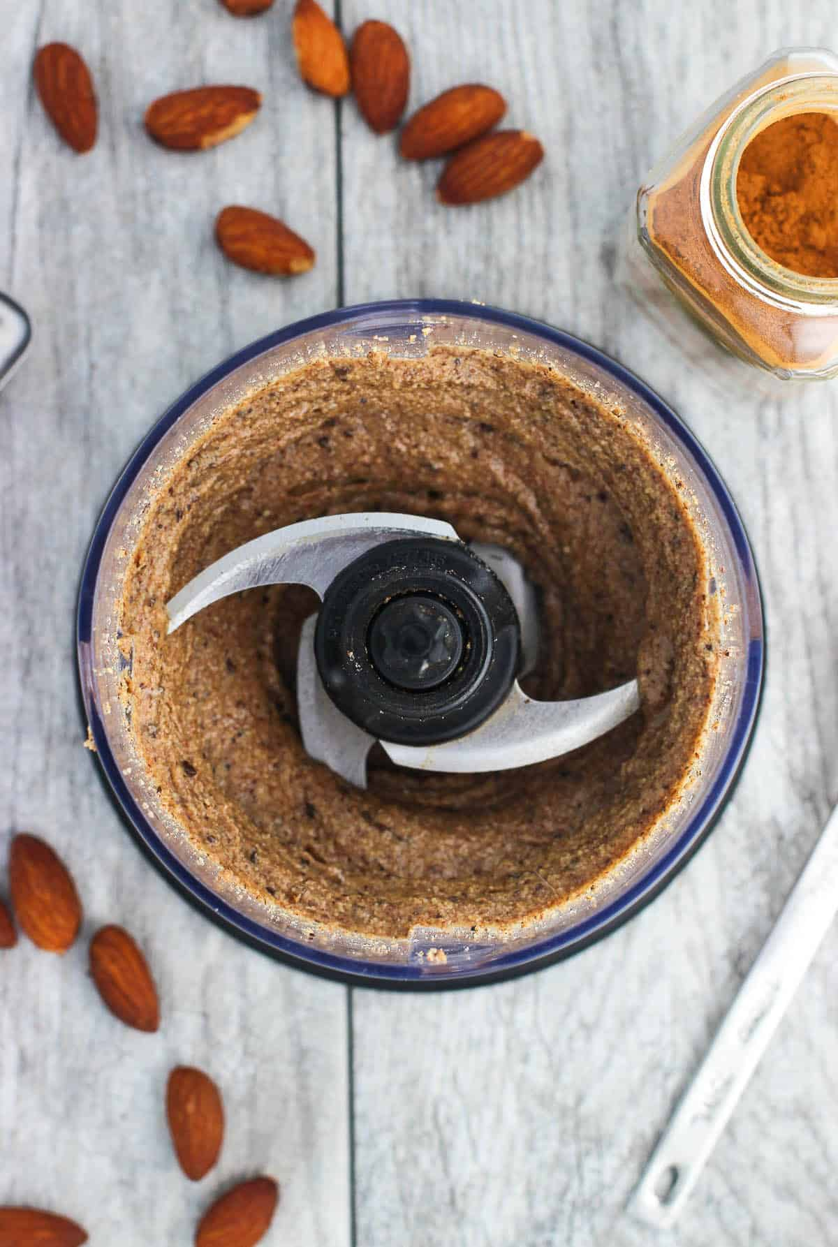 An overhead shot of the almond butter blended up in the food processor