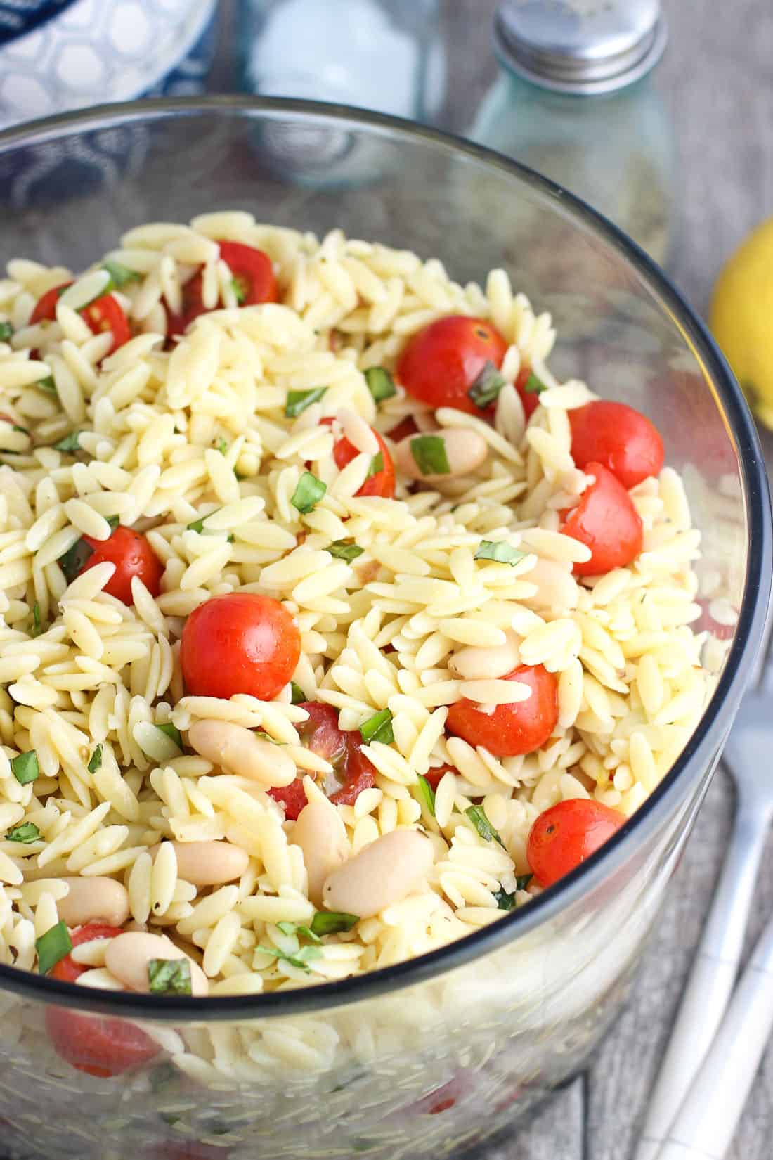 This lemon orzo pasta salad is just the thing for spring and summer! Loaded up with fresh basil, chopped sliced almonds, white beans, and lemon juice, this pasta salad makes a delicious side dish that will feed a crowd.