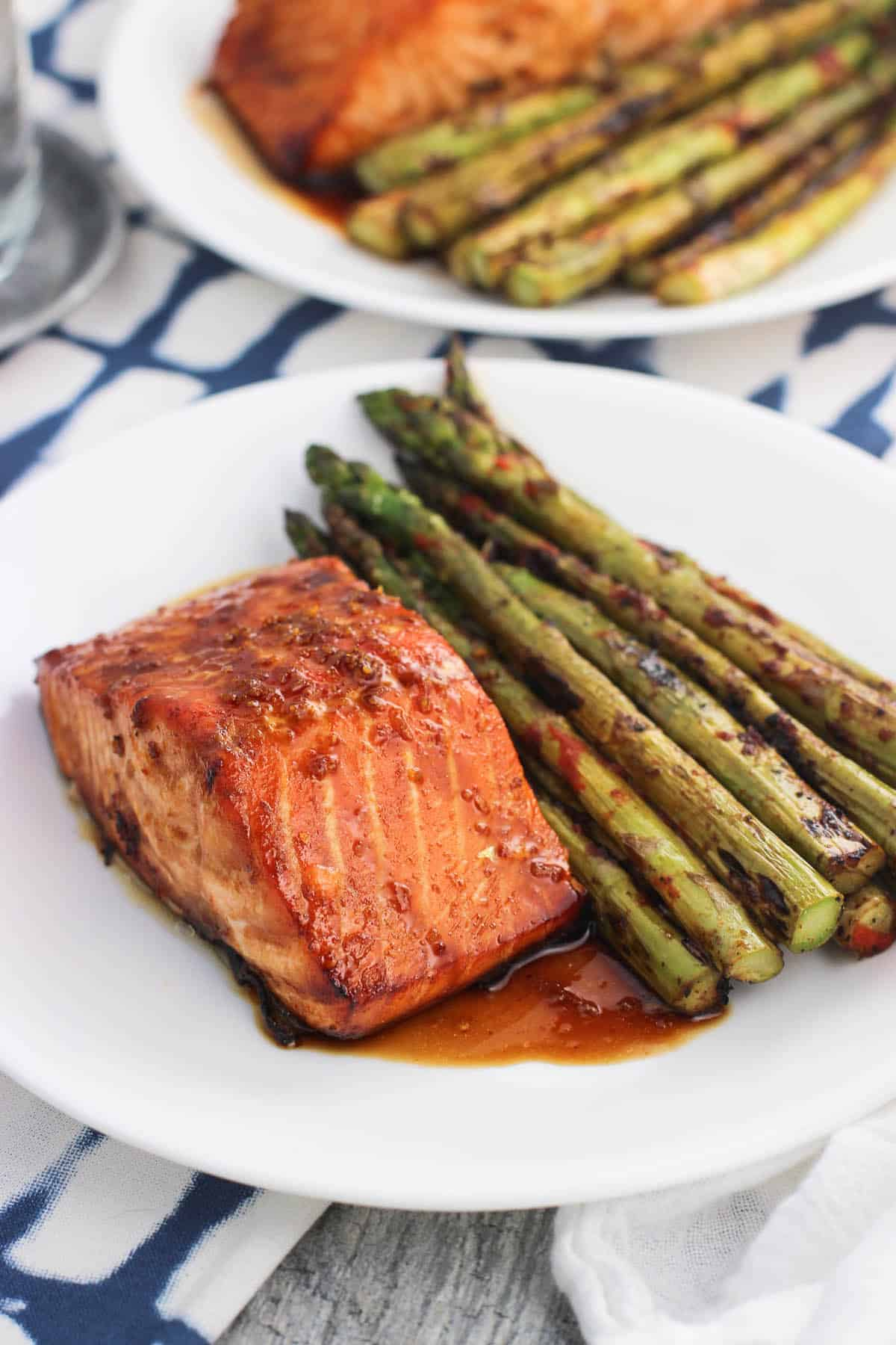 This baked spicy orange salmon recipe takes about 45 minutes from start to finish, including time for a quick marinade! It's a healthy weeknight dinner that uses sriracha, orange zest, honey, and more.