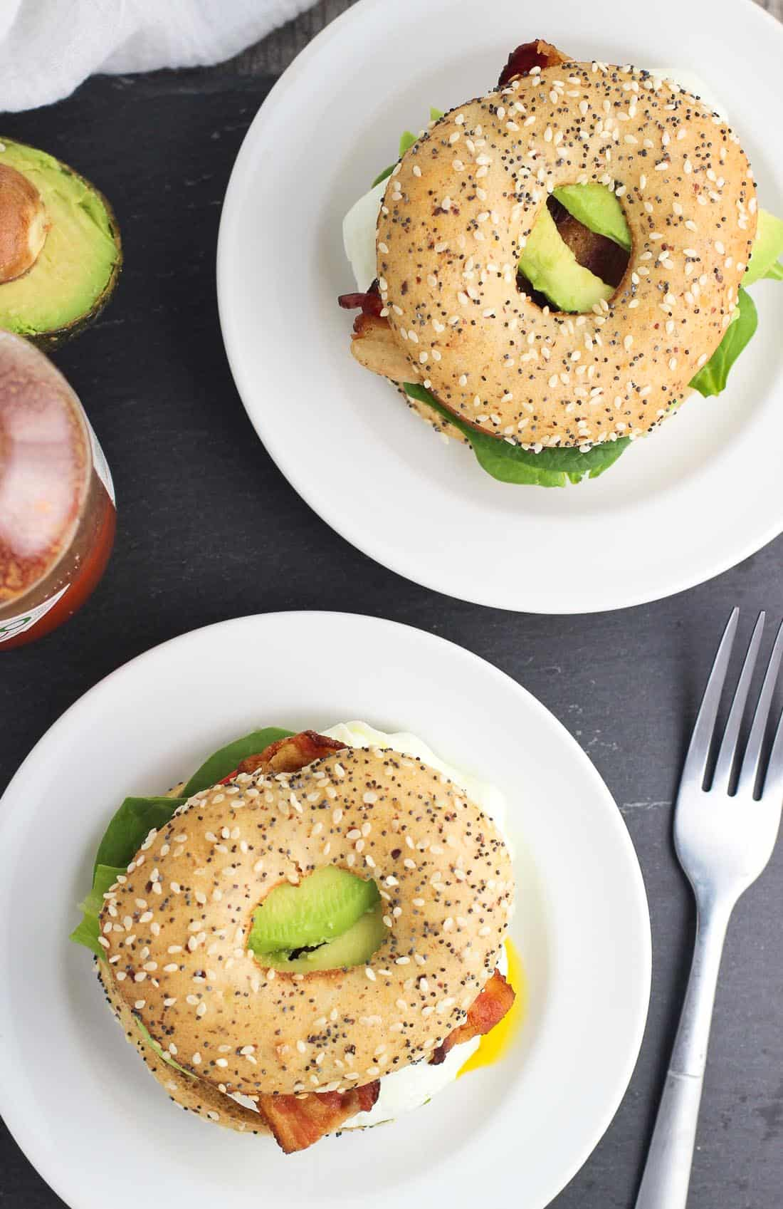 This BLT Breakfast Sandwich is a delicious update to a breakfast staple! An over easy egg is joined by the classic BLT trifecta of bacon, lettuce, and a juicy tomato slice, topped with avocado, and piled high on a toasted bagel thin. This packed breakfast sandwich is easy to make, and works well for any meal of the day.