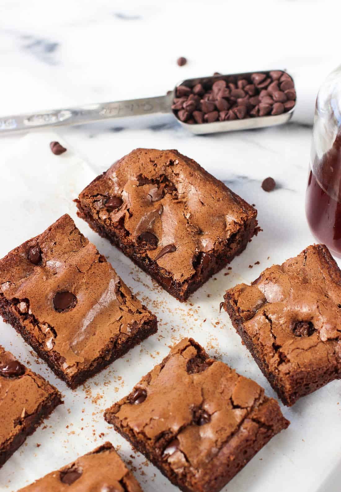 A close-up shot of sliced small batch brownies on a piece of parchment paper
