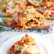 Spicy sausage lasagna rolls are an easy meal recipe full of comfort food flavor without a ton of work (or too many leftovers). Spicy Italian sausage, ricotta and mozzarella cheeses, and fresh basil are rolled in boiled lasagna noodles and topped with your favorite marinara sauce and more cheese for a weeknight-ready meal.