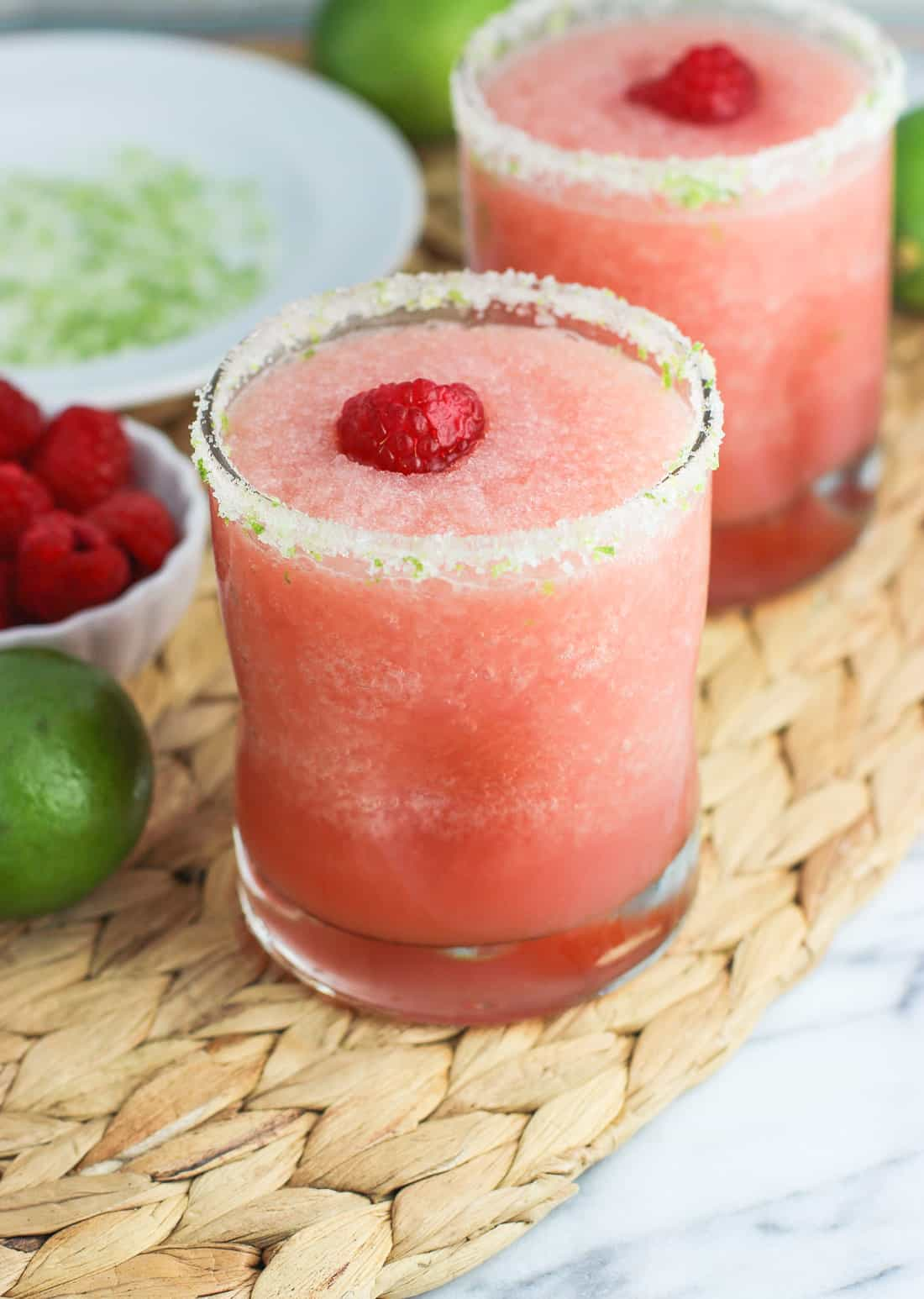 Tropical Citrus Raspberry Frozen Margaritas are a refreshing and better-for-you twist on a summer favorite - frozen cocktails! These margaritas are tart, frosty, and easy.
