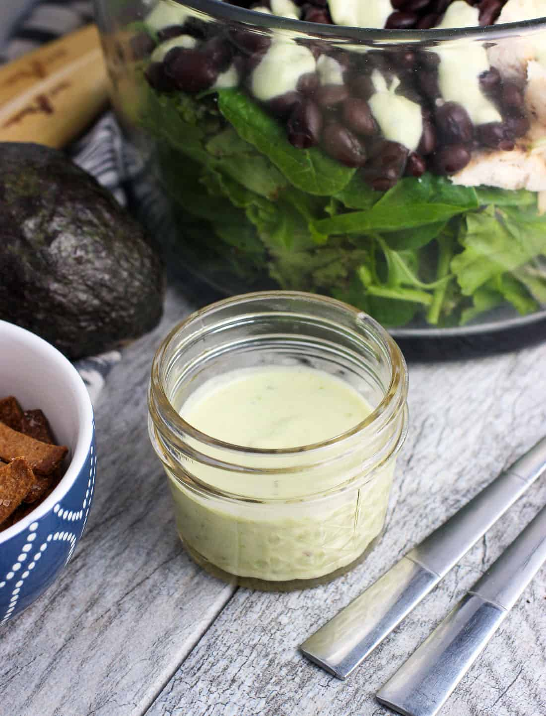 This creamy avocado apple cider vinegar salad dressing that is creamy and tangy all at once.