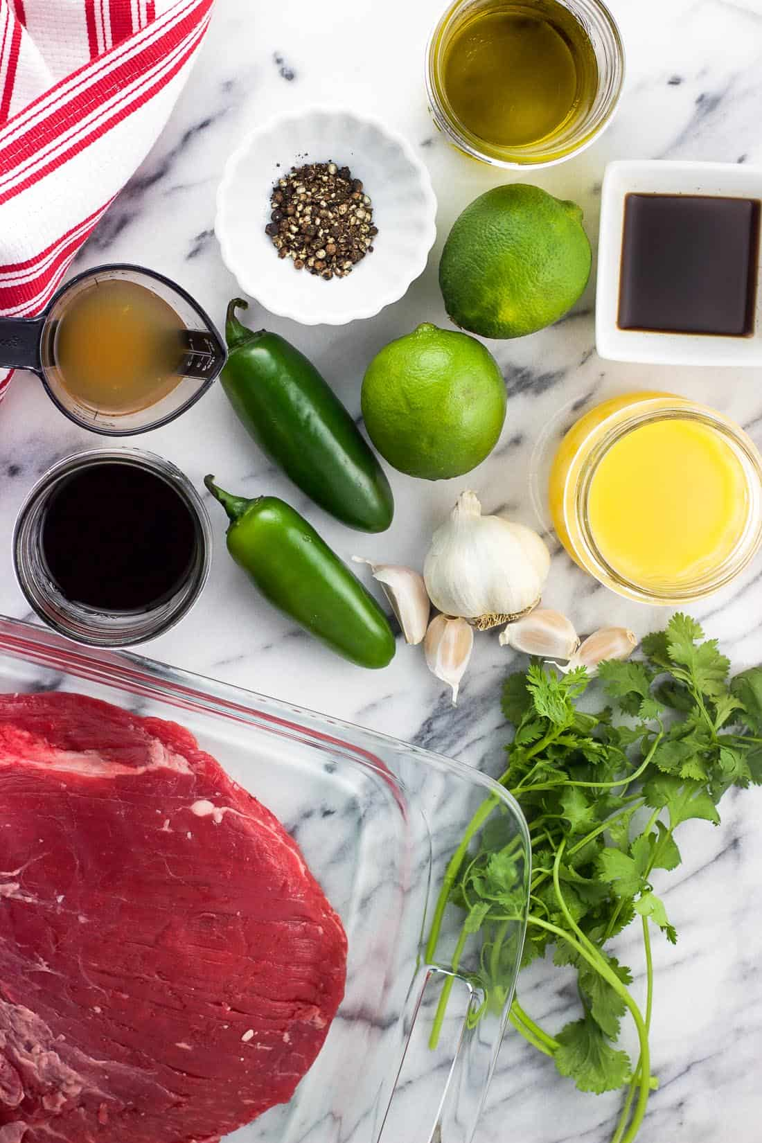 An overhead shot of the carne asada marinade ingredients on a marble board