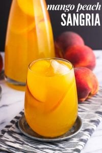 Mango peach white sangria is a fruity, refreshing, and just-sweet-enough spin on a classic cocktail. It's a perfect peach sangria recipe using white wine for spring or summertime entertaining!