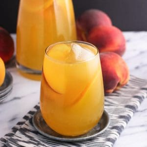 Mango peach white sangria is a fruity, refreshing, and just-sweet-enough spin on a classic cocktail. Perfect for summertime entertaining!