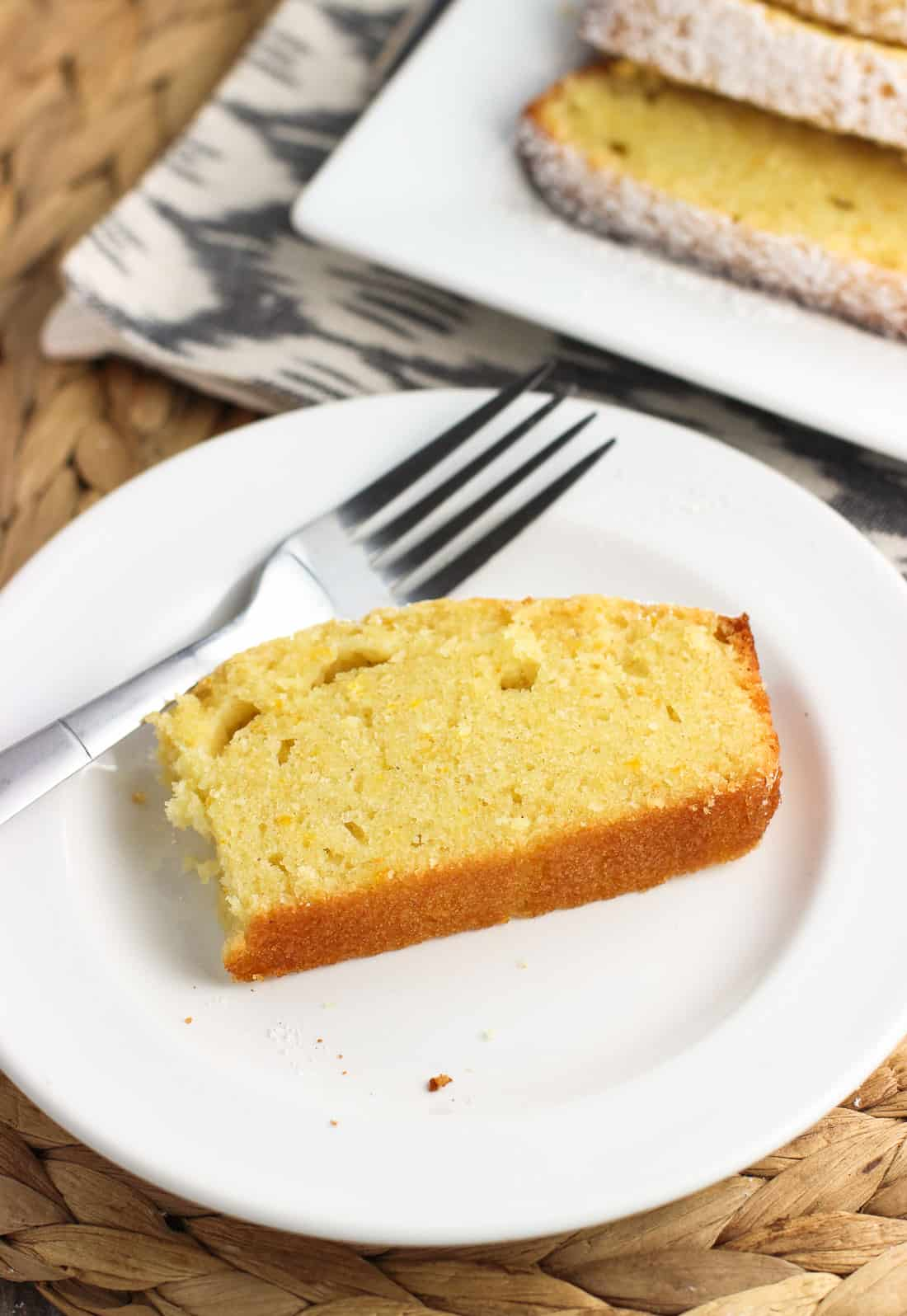 A simple orange pound cake recipe is spiced with nutmeg and dusted with a confectioners' sugar and cinnamon mixture for a warm touch to a classic dessert.