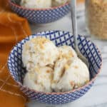 Lemon coconut ice cream is tart, creamy, and packed full of toasted coconut flakes and toasted macadamia nuts. Because it's made with coconut milk it's dairy-free (and vegan)!