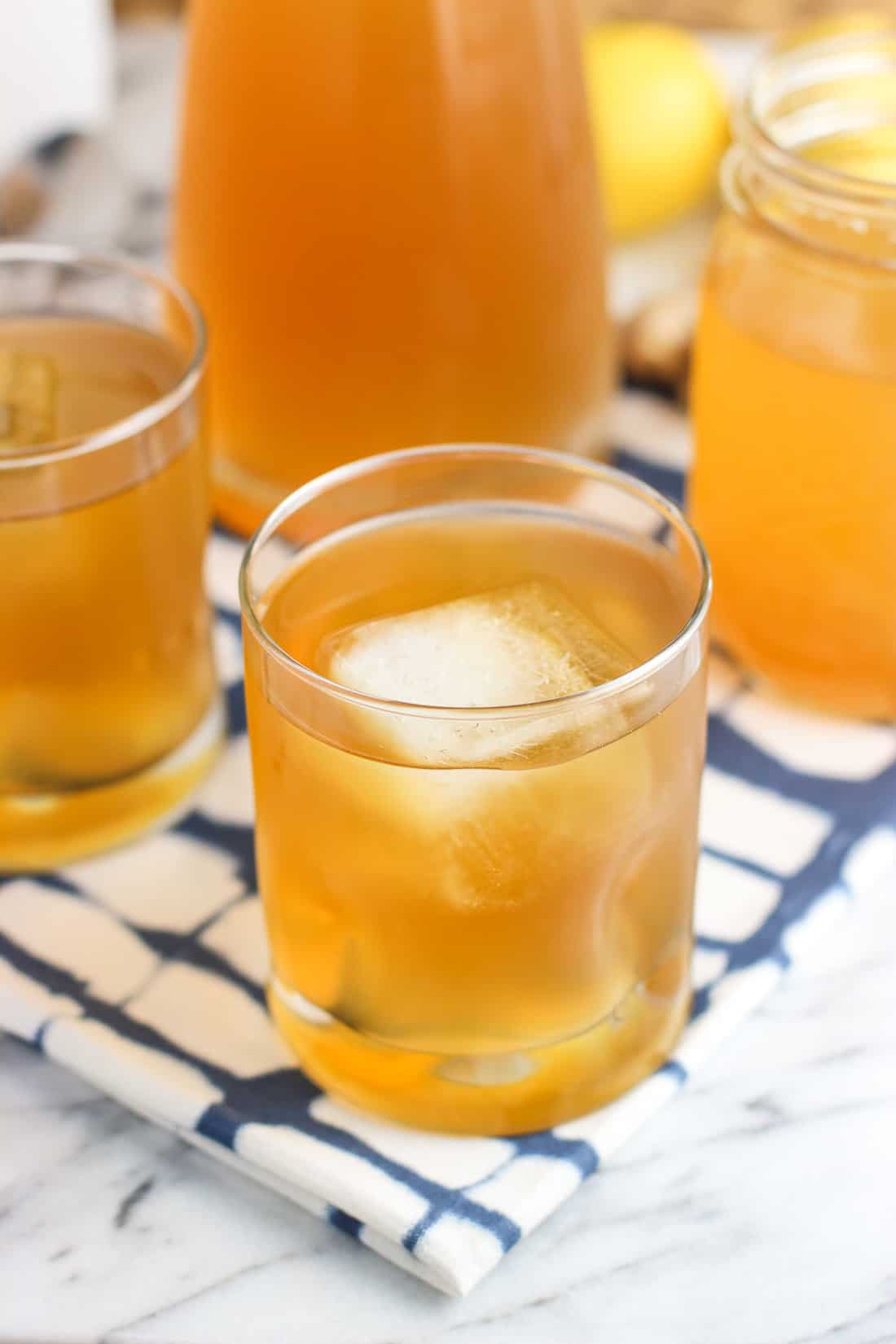 Lemon ginger iced green tea is a refreshing twist on a favorite summer drink. An easy lemon ginger simple syrup uses honey to flavor and sweeten multiple batches to your liking.