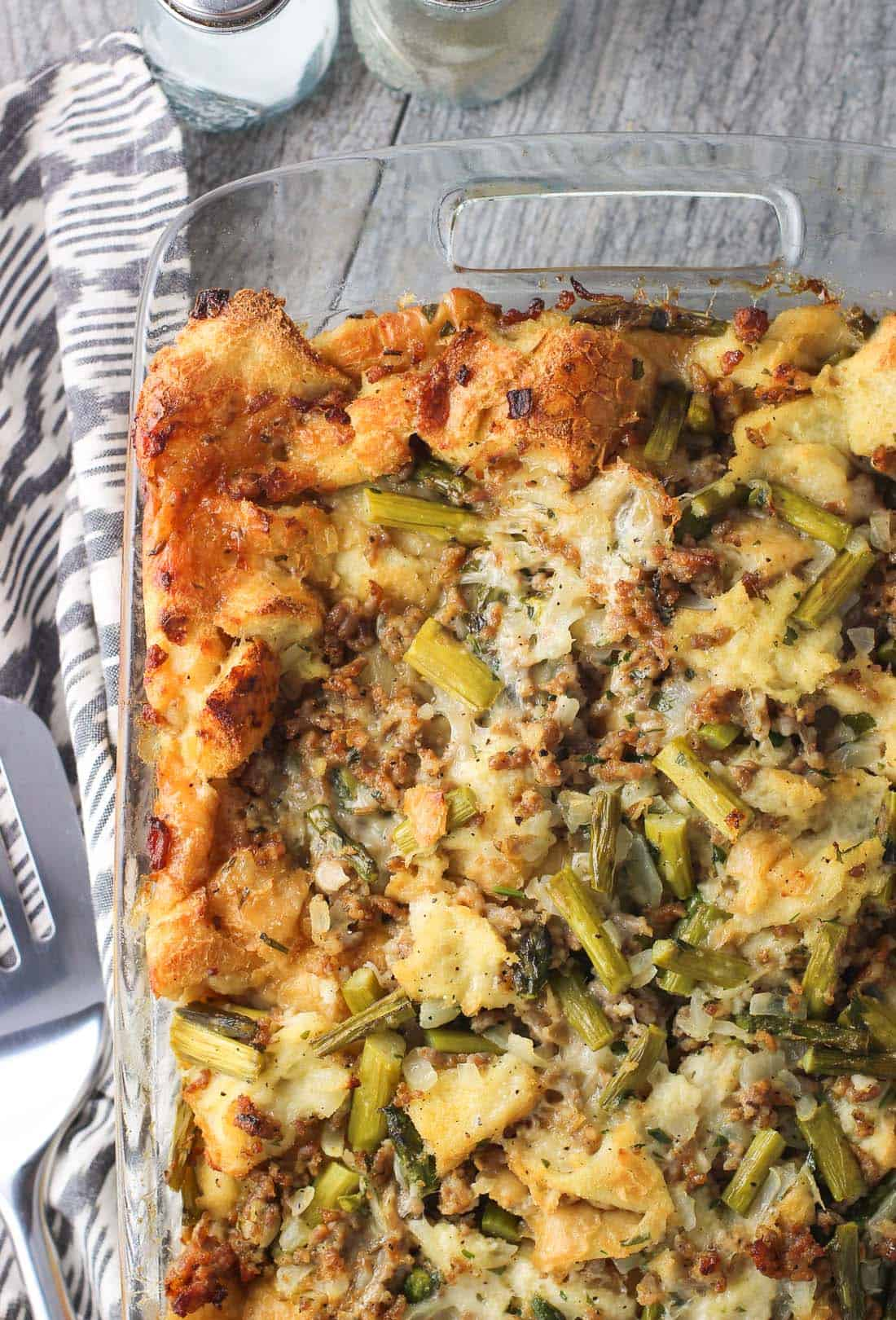 This sausage strata is a savory breakfast bake filled with Italian sausage crumbles, sautéed asparagus, and Asiago cheese. It's the perfect brunch dish for holidays or for entertaining!