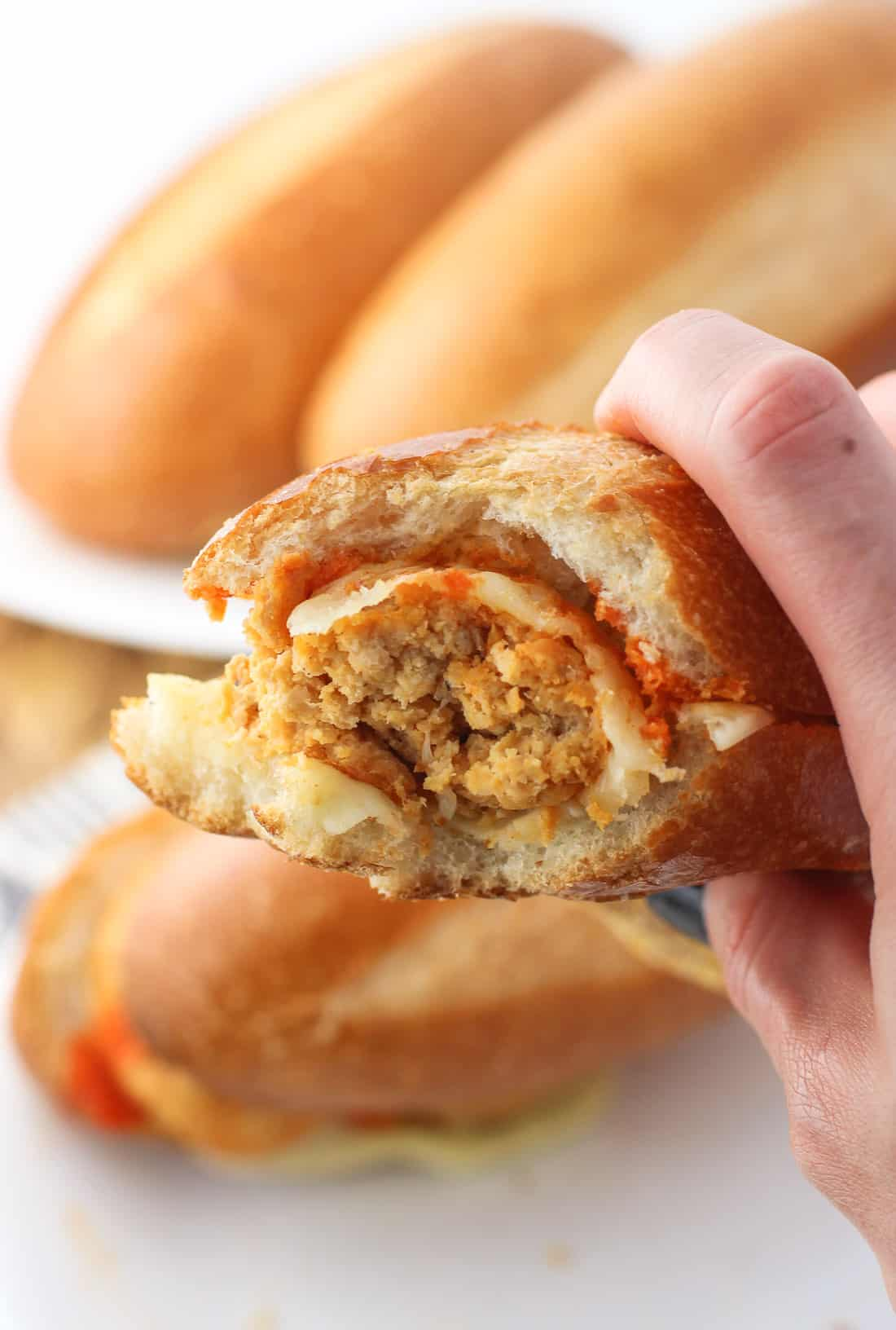 Buffalo chicken meatball subs will be your new comfort food favorite! Ground chicken is mixed with buffalo sauce, breadcrumbs, cheese, and spices for a batch of slightly spicy, juicy, and tender buffalo chicken meatballs. Delicious on a sub with provolone cheese!