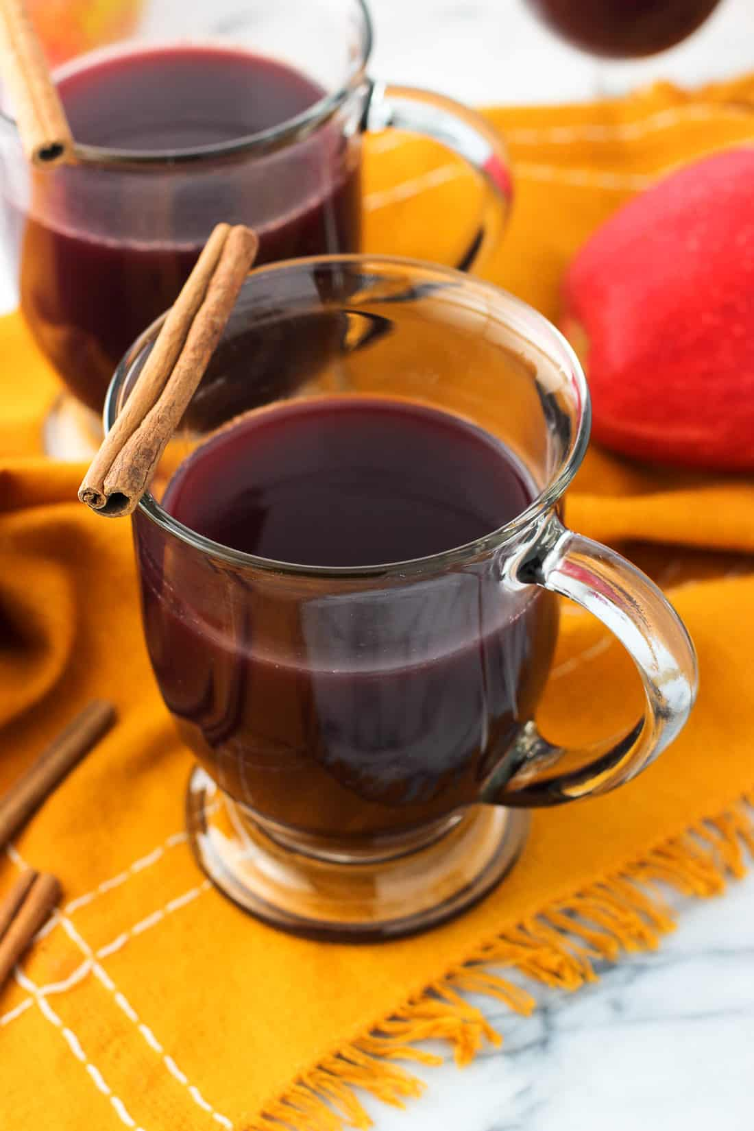 Ginger mulled wine is an easy, warmly-spiced drink that will fill your kitchen with a wondrous aroma. This cozy, semi-homemade version features a spice shortcut with a kick from fresh ginger.