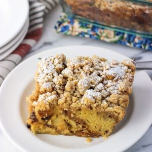 A square of crumb-topped panetonne french toast bake on a plate.