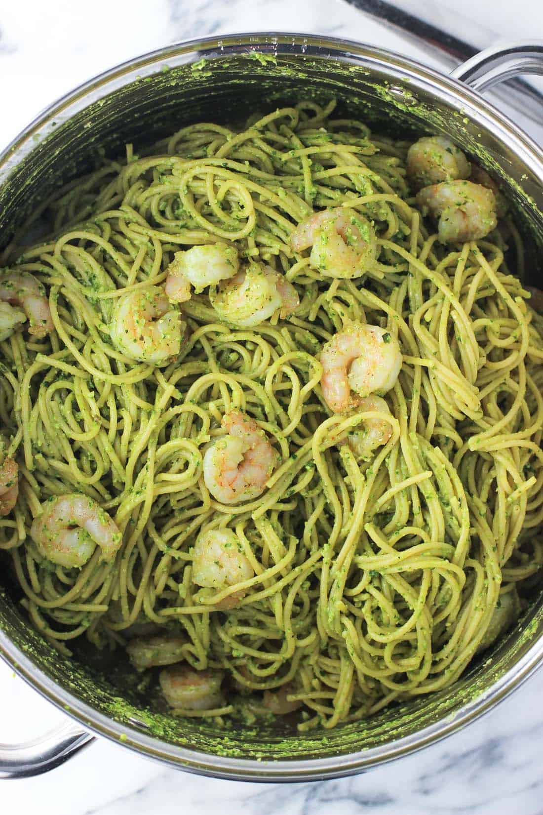 Pesto shrimp pasta makes a great main dish with spinach avocado pesto sauce and shrimp. A few ingredient swaps boost the nutrition of traditional pasta.