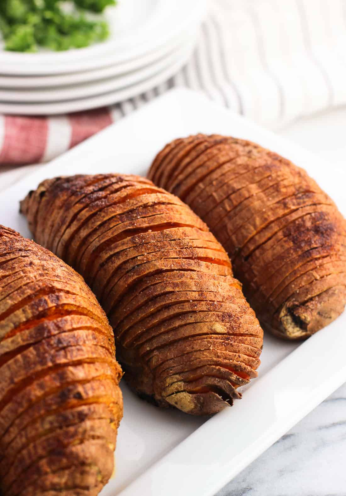Sweet and Smoky Hasselback Sweet Potatoes make a delicious, healthy side dish. The deep slices yield potato strips similar to thin steak fries with crisper exteriors and soft middles. This seasoning is the best!