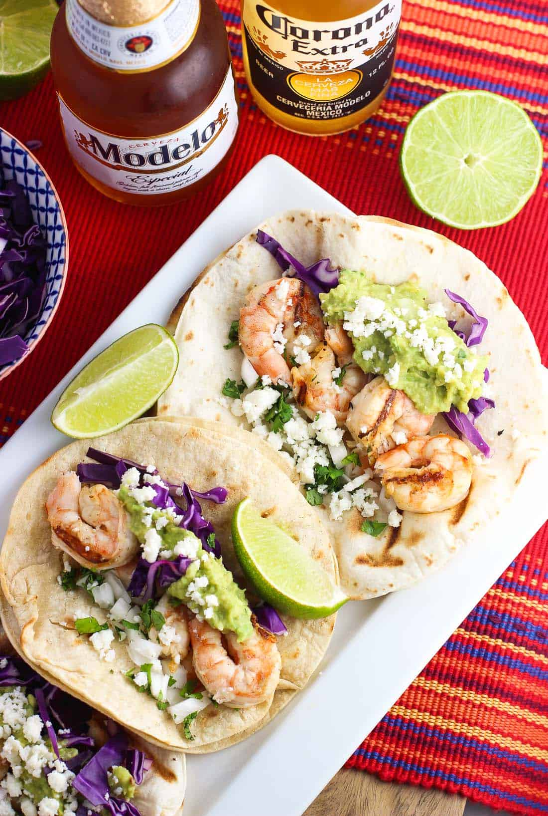 Blackened shrimp street tacos feature quickly marinated lime, honey, and beer shrimp that are grilled to juicy perfection. Just add your favorite toppings to make this perfect Cinco de Mayo meal your own!