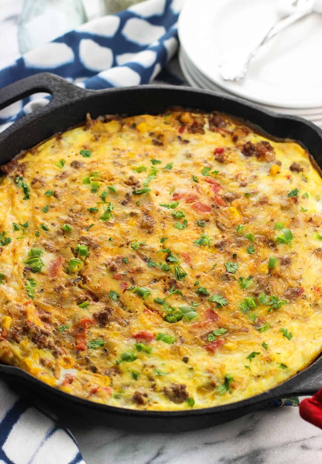 A baked southwestern frittata in a round cast iron pan.