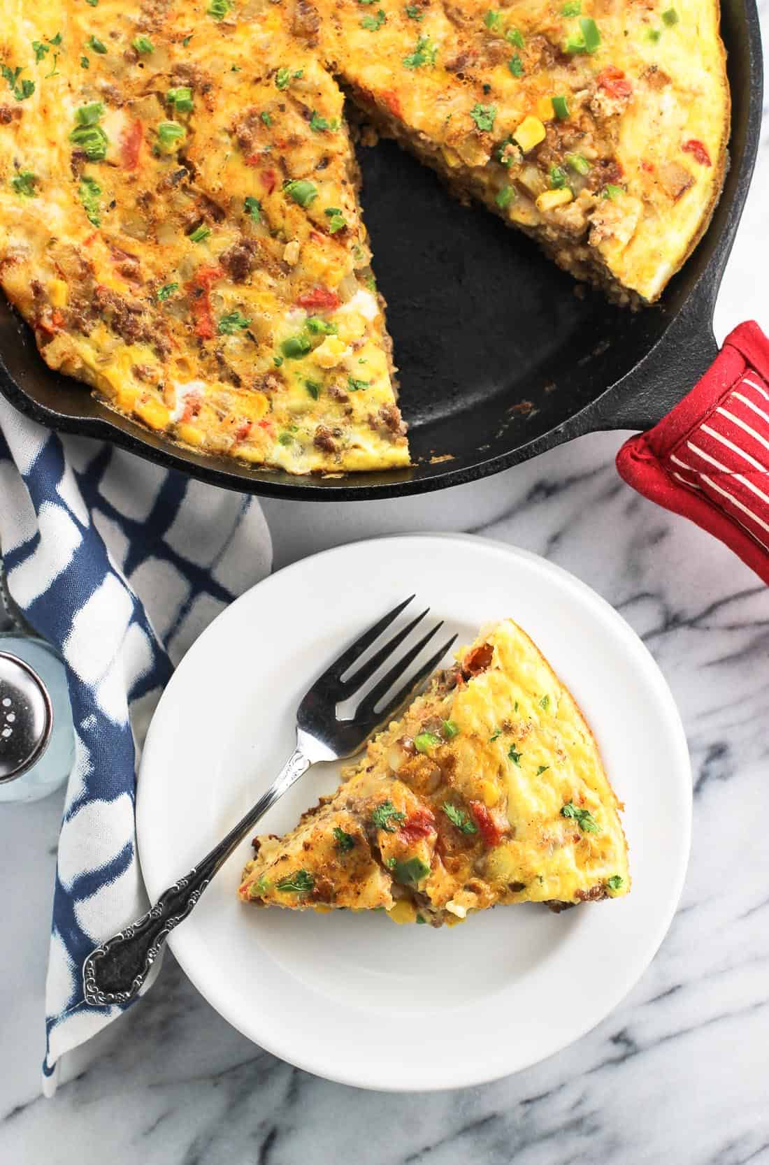 This southwestern frittata is loaded with potato, beef, rice, cheese, veggies, and more for a hearty breakfast, brunch, or anytime meal.