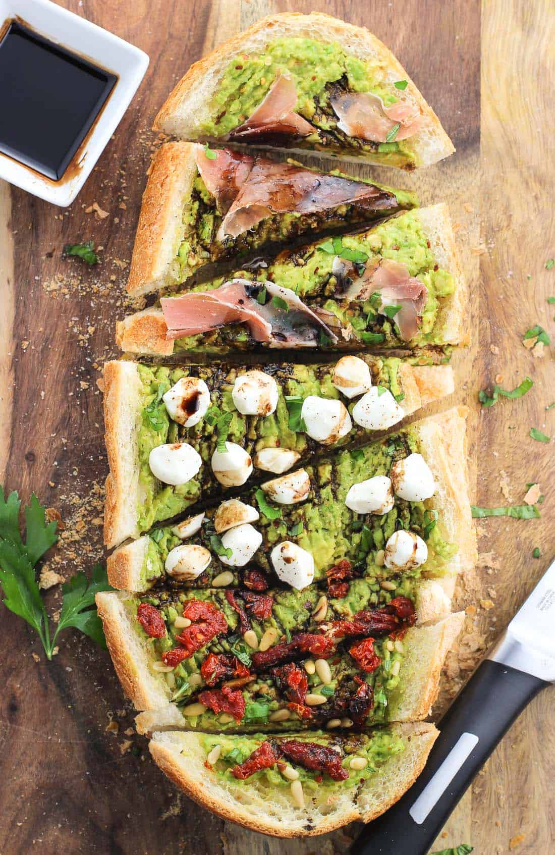 Avocado toast meets garlic bread in this party-perfect loaded avocado garlic bread. Top garlic bread with avocado and your favorite toppings and slice for a fun appetizer, snack, or light meal.
