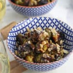 These crispy brussels sprouts are roasted at a high heat and covered in a soy and sesame glaze for a crisp exterior and a tender center. Adding puffed rice right before serving adds an unexpected crunch! This recipe makes a great appetizer or tapas dish.