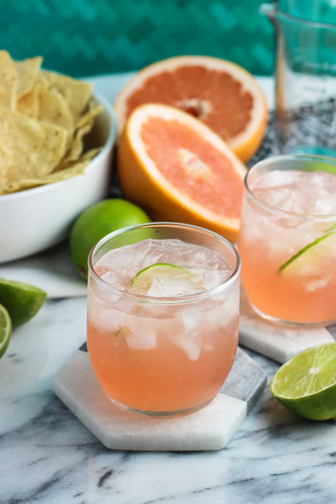 Fruity vodka sodas are an easy summer cocktail recipe perfect for backyard BBQs, lounging poolside, and more. Minimal ingredients are needed to make either pineapple mint or grapefruit lime versions - both are flavorful and refreshing!